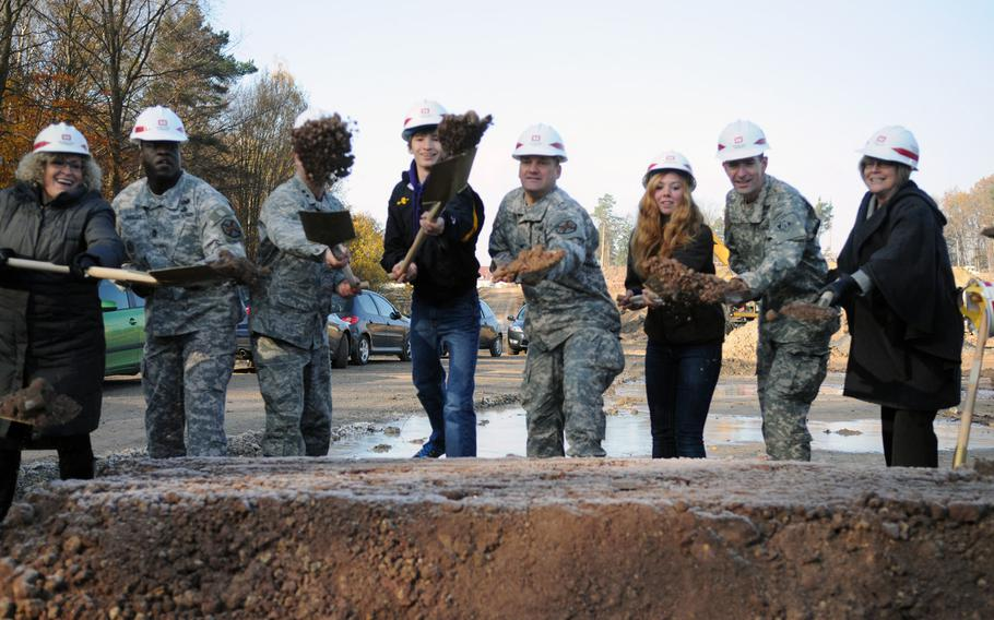 Army officials from Stuttgart, the Army Corps of Engineers and students from Patch High School take part in the groundbreaking ceremony Tuesday at the site of the future Stuttgart High School and Stuttgart Elementary School.