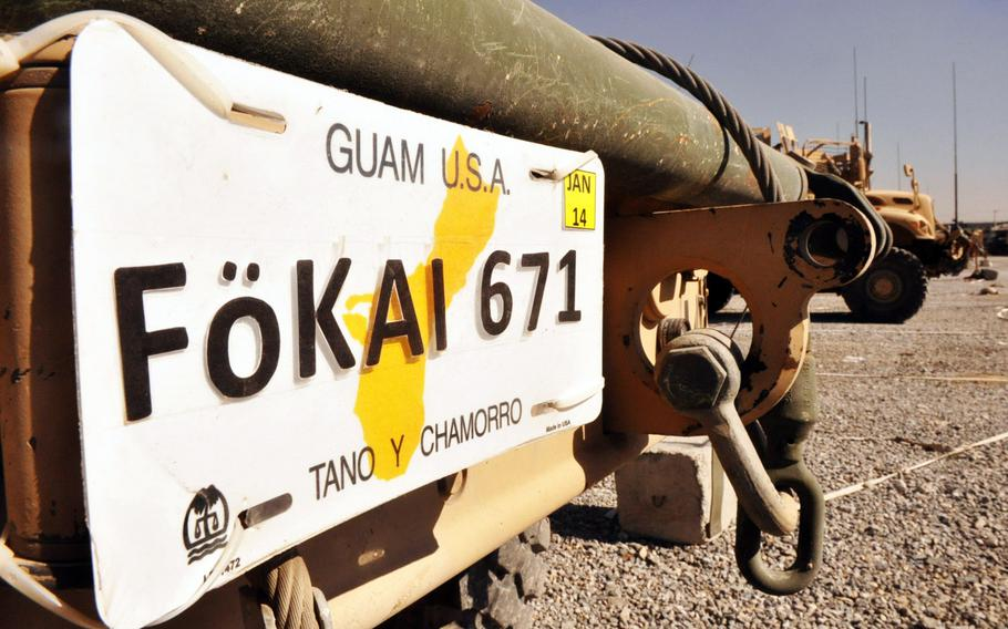 """A license plate on the front of an MRAP for Task Force Guam at Camp Phoenix in Kabul. The plate reads, """"Tano y Chamorro,"""" which means """"the land and the people"""" in the Chamorro language spoken in Guam. Chamorro is also the word that refers to the indigenous people of Guam and the Mariana Islands where Guam is located."""