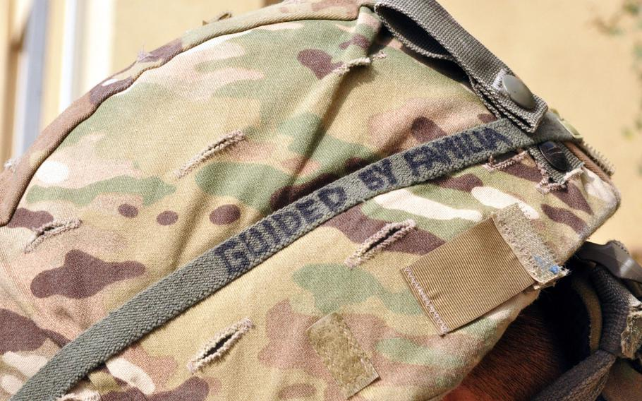 """The helmet of public affairs officer Sgt. Edward Siguenza, a California Army National Guardsman attached to Task Force Guam at Camp Phoenix in Kabul. Siguenza was born and raised in Guam before moving with his family to California in 2004. His helmet reads, """"Guided by familia."""""""