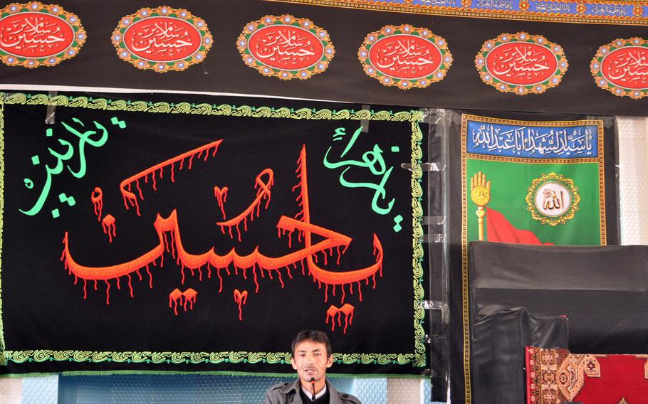 An imam gives an Ashura sermon Thursday at a mosque in Bamiyan, Afghanistan. Ashura is a day of mourning for Shia Muslims, commemorating the martyrdom of Hussein Ibn Ali, grandson of the prophet Muhammad. Observances of the day are more tame in Afghanistan than in parts of the Middle East, where Shias will sometimes flog themselves bloody.
