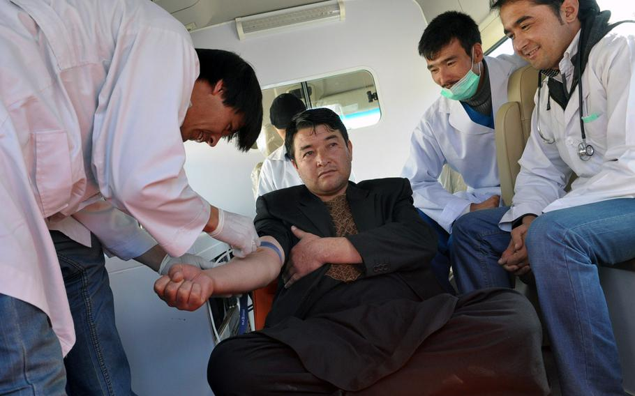 A man donates blood in Bamiyan, Afghanistan, Thursday before services for Ashura, one of the holiest days of the year for Shia Muslims. While some Shias whip themselves bloody for the holiday, the governor of Bamiyan province encouraged the faithful to donate blood instead.