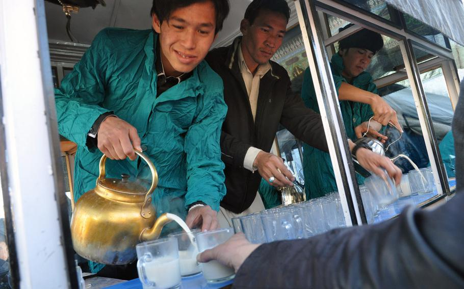 Afghans pour sweet hot milk to worshippers leaving Ashura services Thursday in Bamiyan, Afghanistan. Ashura is a day of mourning for Shia Muslims, commemorating the martyrdom of Hussein Ibn Ali, grandson of the prophet Muhammad.