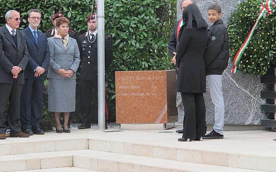 Curry's son, Kevin, looks out from the podium during the ceremony, with his widowed mother, Lucia, at his side. Left are Tranquillo Frison, who thought of and paid for the monument to his son and Curry, the prefect of Padua and Frison's wife.