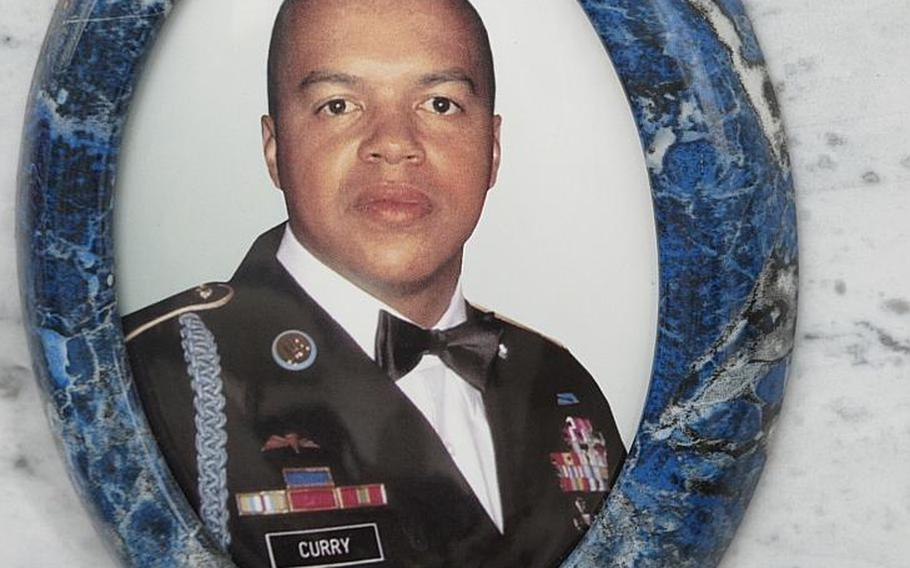 1st Sgt. Michael Curry was born in the U.S., died in Afghanistan and was buried in Italy where he'd made his home and life. His photograph appears on his cemetery site in Grantorto, Italy.