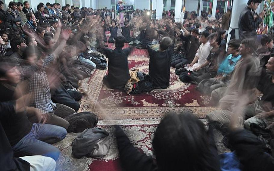 Worshipers at a mosque in Bamiyan, Afghanistan beat their chests to mourn the killing of Hussein Ibn Ali, grandson of the Muslim prophet Muhammad. The ritual is part of Ashura, one of the holiest days of the year for Shia Muslims.