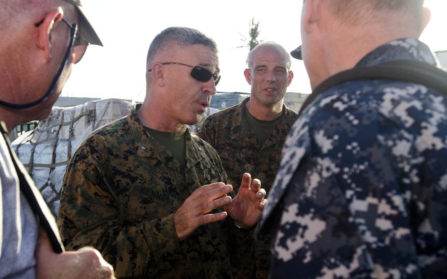 Marine Brig. Gen. Paul Kennedy, commander of Operation Damayan, the typhoon relief effort in the Philippines, discusses operations with personnel assisting in the relief effort at Tacloban Airport on Nov. 15, 2013.  Eric Guzman/Stars and Stripes