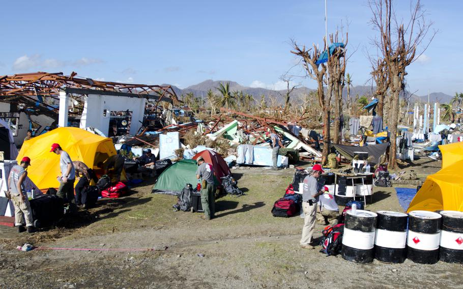 U.S. Venterans with Team Rubicon set up a camp at Tacloban Airport. They are actively assisting in the relief effort in areas of the Philippines hit by Super Typhoon Haiyan.  Eric Guzman/Stars and Stripes