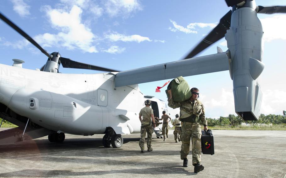 U.S. Army troops helping with the Super Typhoon Haiyan relief effort unload their gear from a V-22 Osprey after landing at an airstrip in Borongan, Philippines.