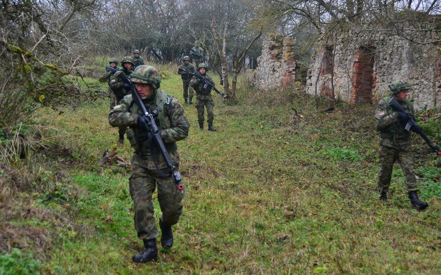 Serbian forces maneuver toward their objective during the Combined Resolve exercise Nov. 17, 2013, at the Joint Multinational Readiness Center in Hohenfels, Germany. The intent of the exercise is to train and prepare U.S. led multinational brigades to interoperate with multiple partner nations against a complex threat.