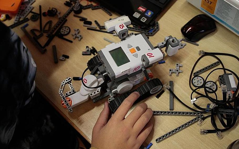 A student builds and programs a robot Tuesday, Nov. 19, at the DODDS-Europe STEMposium in Oberwesel, Germany. The event included 108 students from DODDS high schools across Europe, and steeped them for a week in various aspects of science, technology, engineering and math.