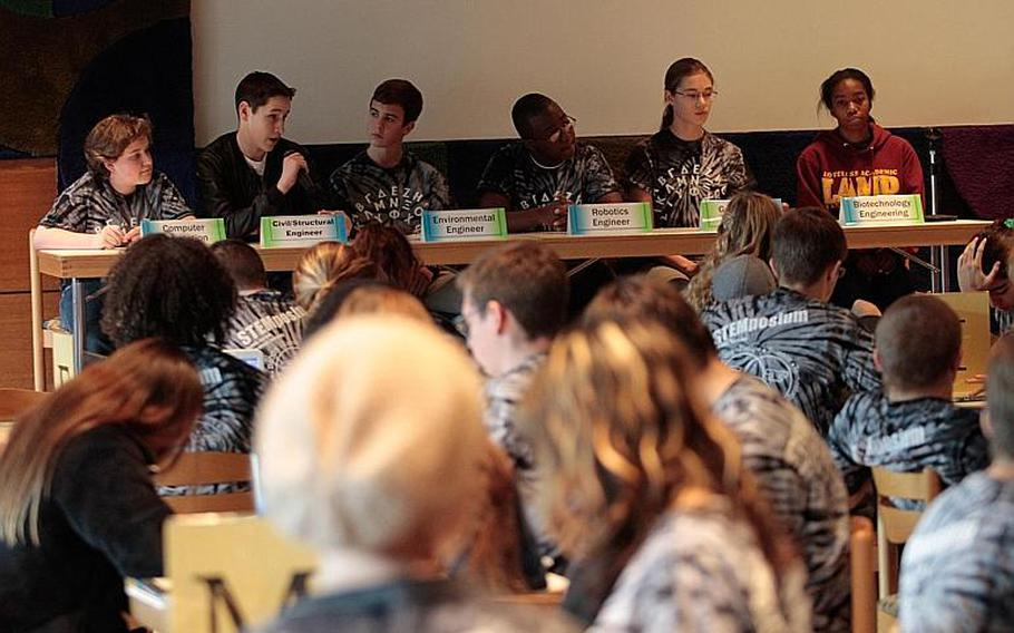 A team of students representing six engineering disciplines answers questions from teachers during a press conference Tuesday at the DODDS-Europe STEMposium. The questions test students' understanding of a fictional disaster scenario and the solutions they're developing to recover from it.