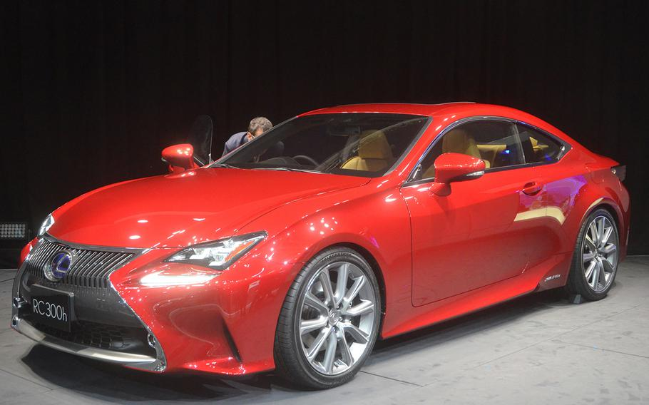 Electric cars and hybrids -- like the Lexus RC 300h, shown here -- are receiving prominent showroom space at several top manufacturers' pavilions during the 2013 Tokyo Motor Show.