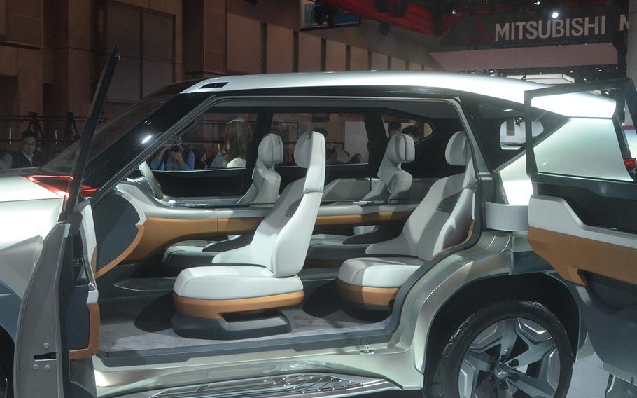 Mistubishi's latest SUV concept includes a center console computer that extends into the back passenger seats.