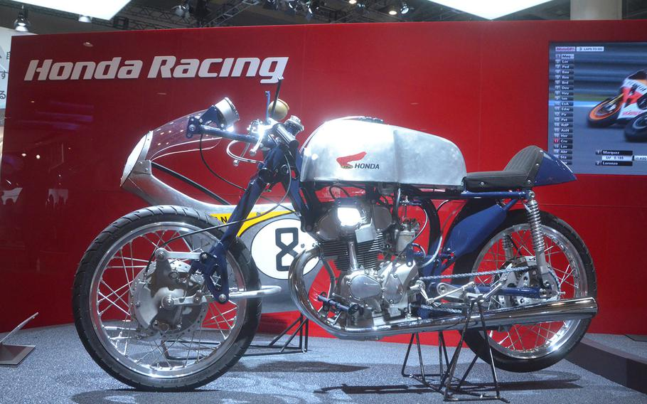 Honda's classic 1959 RC-142 motorcycle is on display at the 2013 Tokyo Motor Show.