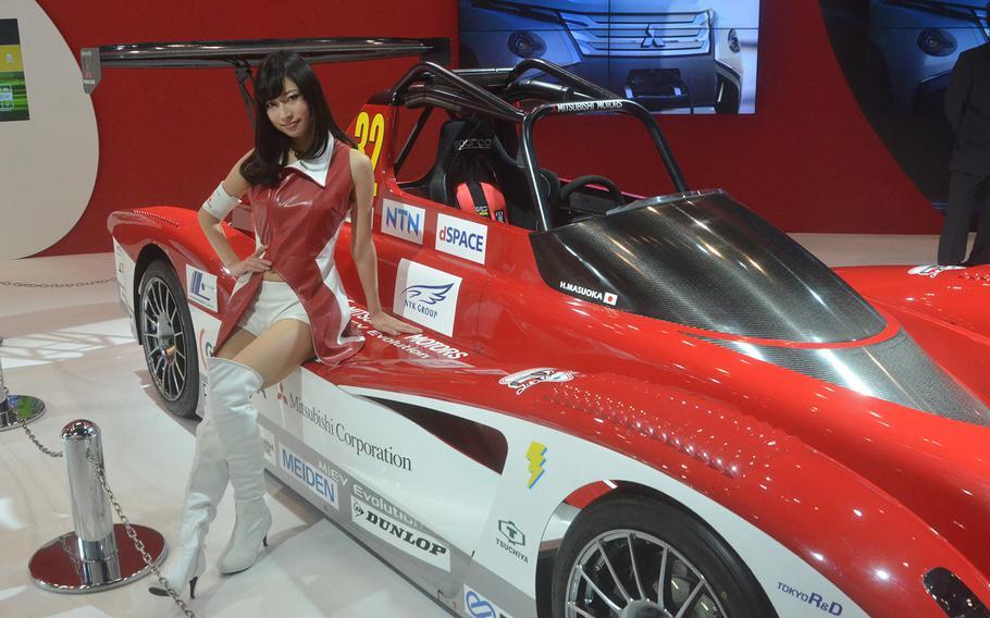 Hiroshi Masuoka's Mitsubishi racer is on display at the 2013 Tokyo Motor Show.