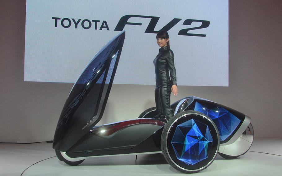 Toyota shows off its FV2 driving simulator at the 2013 Tokyo Motor Show.