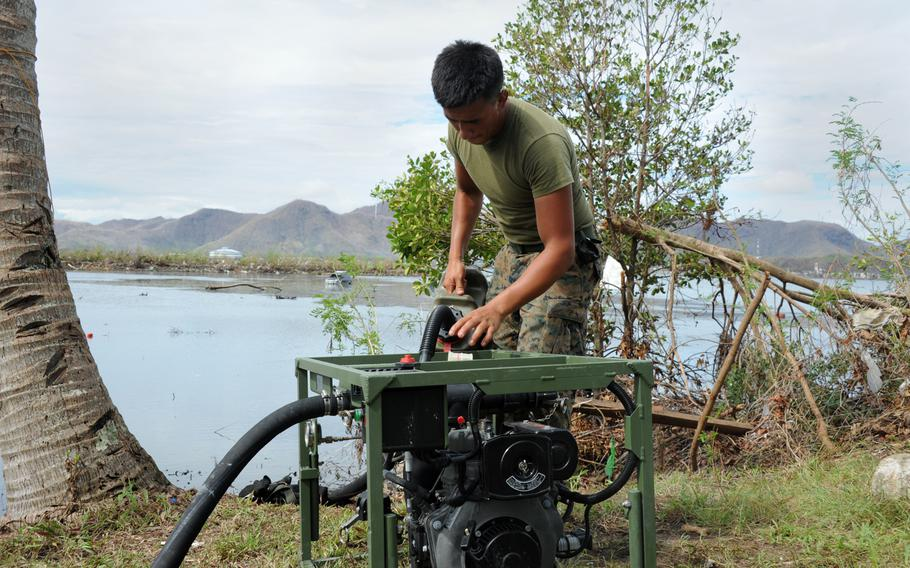 Lance Cpl. Zachary Badial from the 9th Engineer Support Battalion refuels a raw water pump near the Tacloban airport. U.S. Marines have purified more than 100 thousand gallons of ocean water for use by typhoon victims.