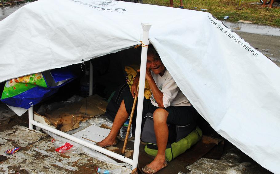 A woman waits for air evacuation at Guiuan on Nov. 21, 2013.