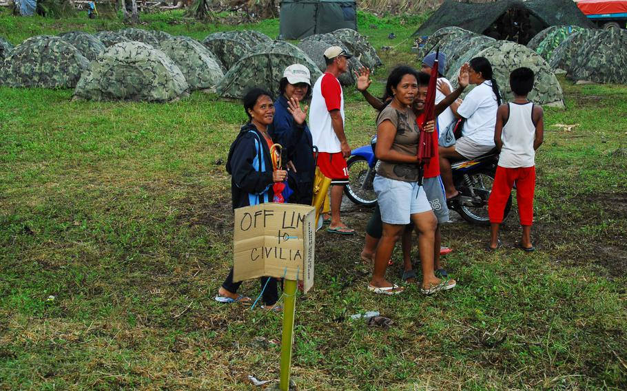 U.S. Marines were camped close to where typhoon survivors waited for air evacuation at Guiuan on Thursday, Nov. 21, 2013.
