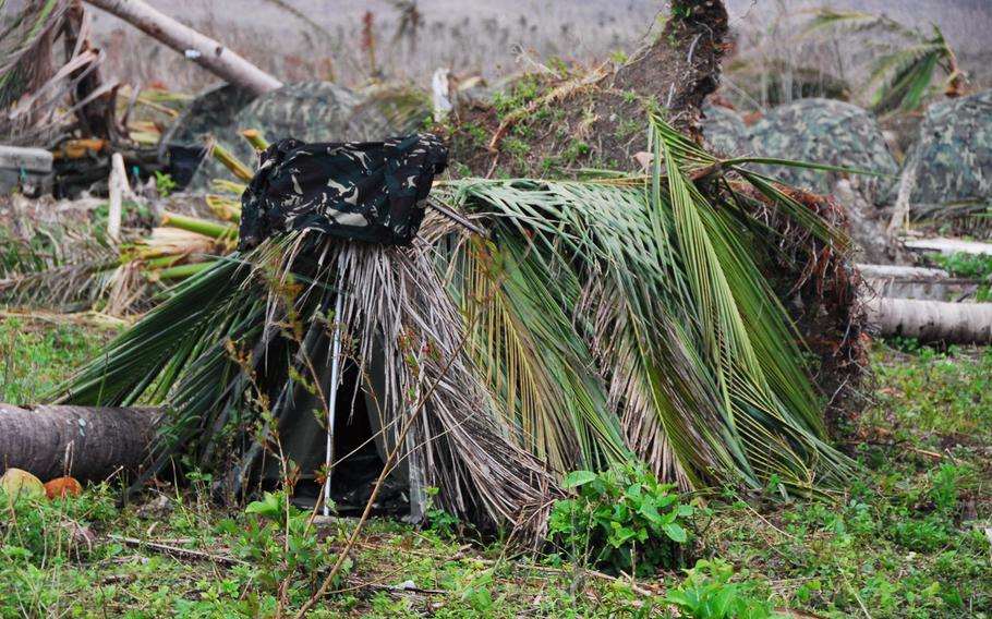 Filipino troops who replaced U.S. Marines at Guiuan Airport this week placed coconut fronds over their tents to help stay dry in monsoon rains.