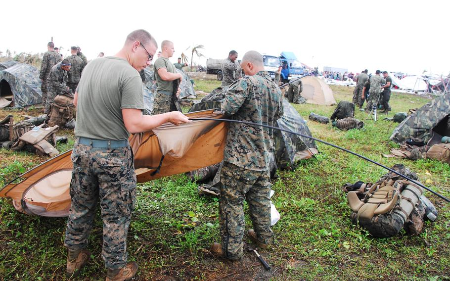 U.S. Marines break camp at Guiuan, Philippines, on Nov. 22, 2013. After more than a week on the ground helping Typhoon Haiyan victims, the Marines are packing up and heading back to Okinawa.