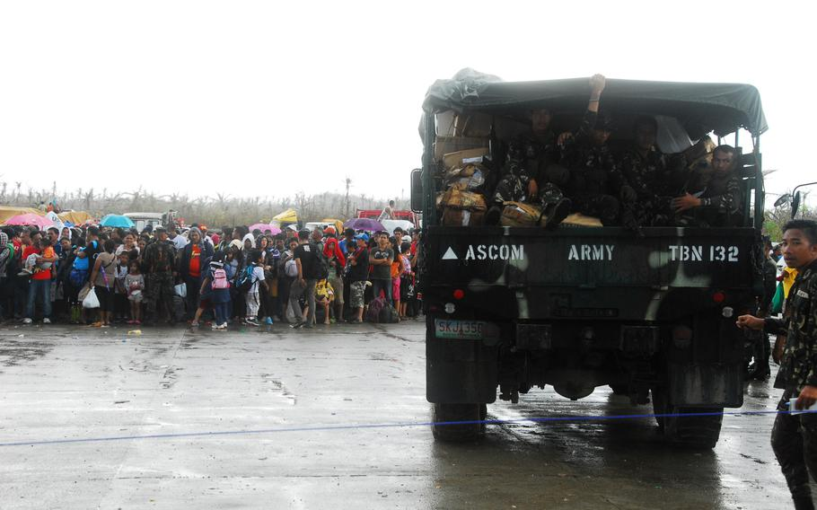 Filipino troops arrive to help control crowds at Guiuan Airport in the Philippines on Nov. 22, 2013.