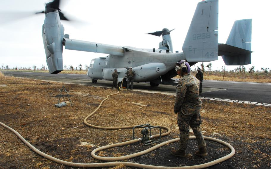 Marines load jet fuel from a forward refueling point at Guiuan into a V-22 Osprey on Friday. After more than week on the ground helping Typhoon Haiyan victims, the Marines are packing up and heading back to Okinawa.