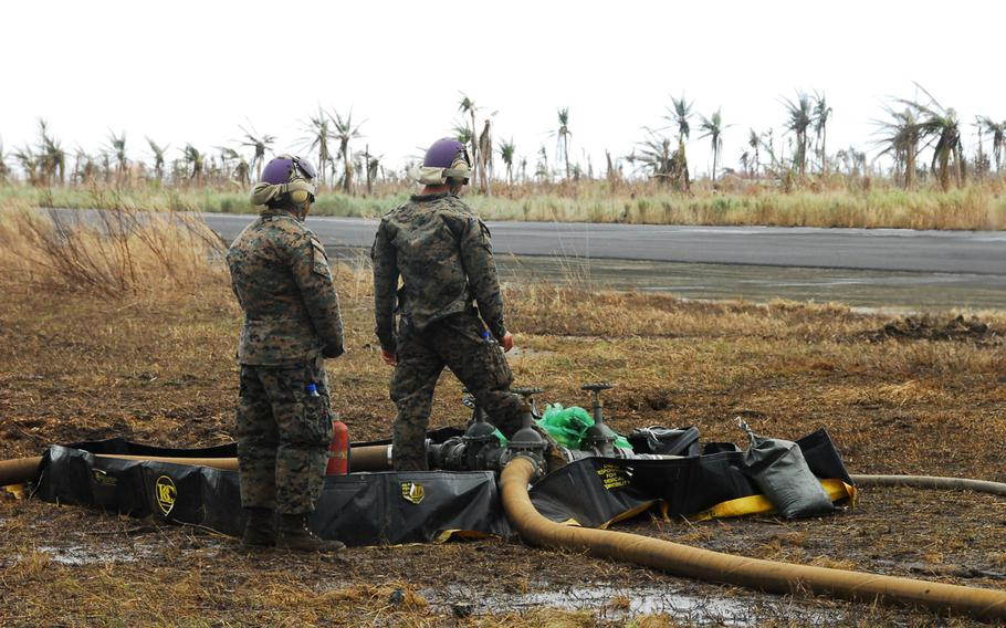 Marines pump the last drops of jet fuel out of a forward refueling point at Guiuan in the Philippines on Nov. 22, 2013.