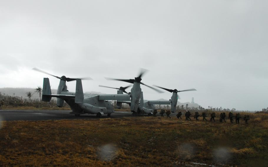 Marine Ospreys prepare to take off from the Guiuan airport in the Philippines on Nov. 22, 2013. After more than a week on the ground helping Typhoon Haiyan victims, the Marines are packing up and heading back to Okinawa.