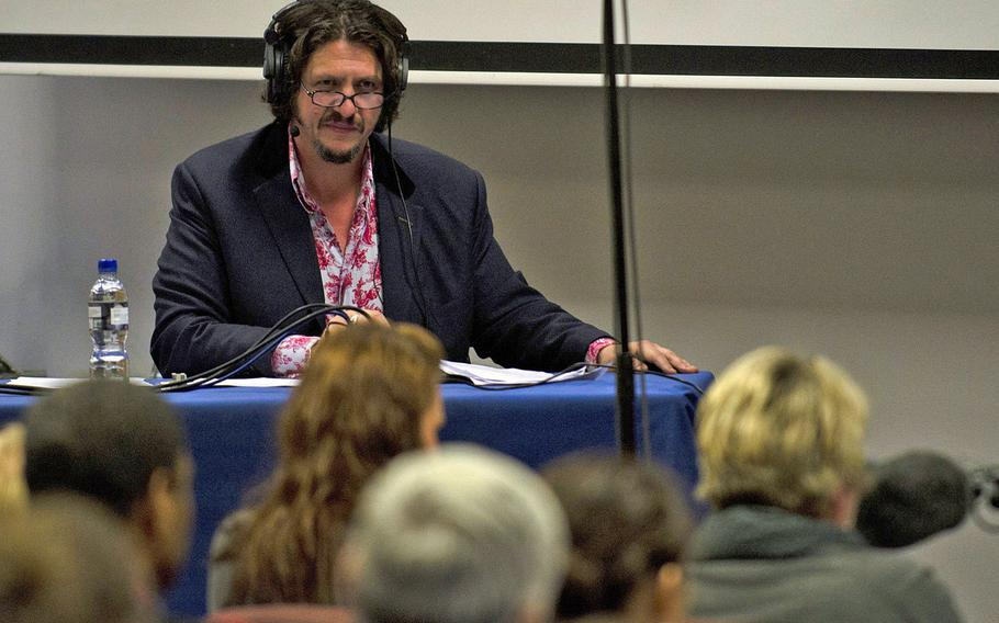"""Host of """"The Kitchen Cabinet"""" Jay Rayner asked the radio audience for on-air comments and posed questions to the panel of food experts, during a recording of the show Tuesday, Nov. 19, 2013, at RAF Lakenheath, England. The experts answered questions from the audience and talked about the differences between English and American cuisine."""