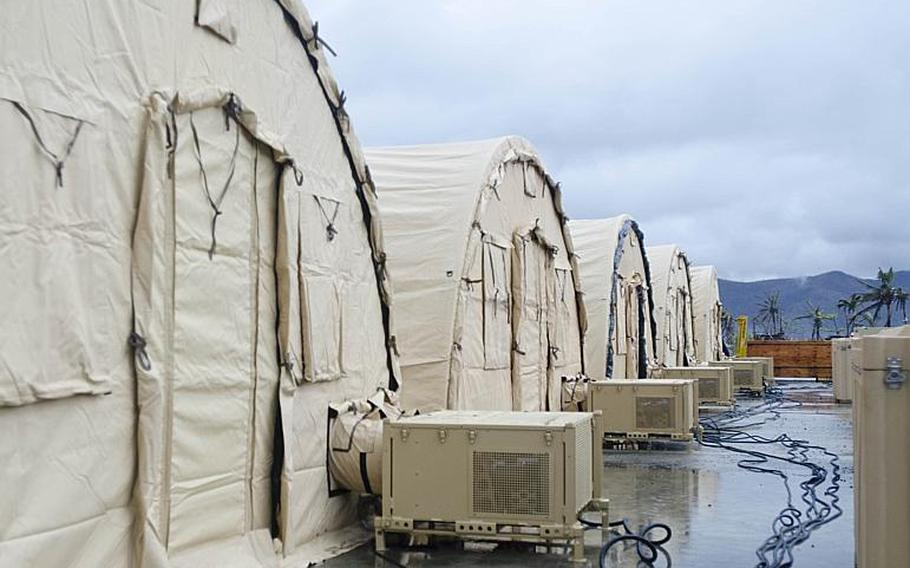 Shelters were donated to the Philippines to help house refugees and non-government organization volunteers. The shelters were stood up near Tacloban Airport, Tacloban, Philippines on November 21, 2013.