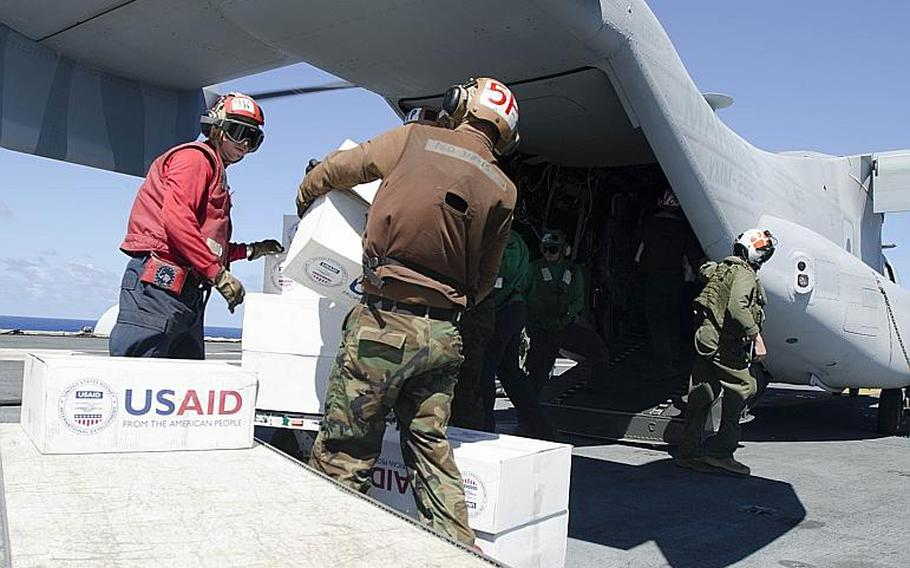 Sailors load relief supplies bound for the Philippines aboard a V-22 Osprey on the USS George Washington aircraft carrier last week.