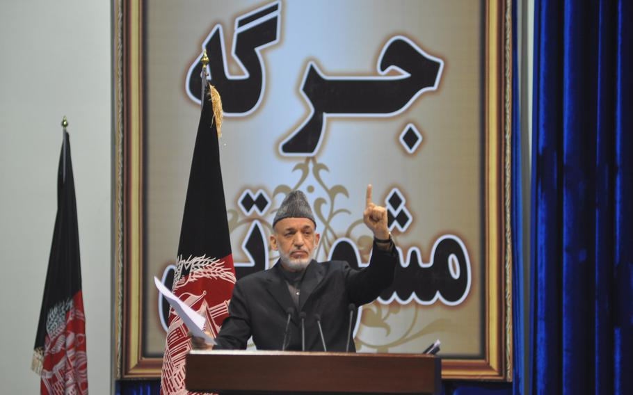 Afghan President Hamid Karzai addresses the Loya Jirga, a gathering of Afghan leaders that convened to discuss a proposed security agreement with the U.S. to keep a military training and assistance force in Afghanistan past the end of 2014. The jirga approved the pact, which goes to parliament for approval and must ultimately be signed by Karzai, who has endorsed it.   Heath Druzin/Stars and Stripes