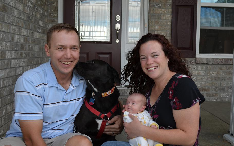 Marc and Sallie Bailey pose with daughter Violet Ann (and their pet dog Maggie) in early September. Violet was born Aug. 30.