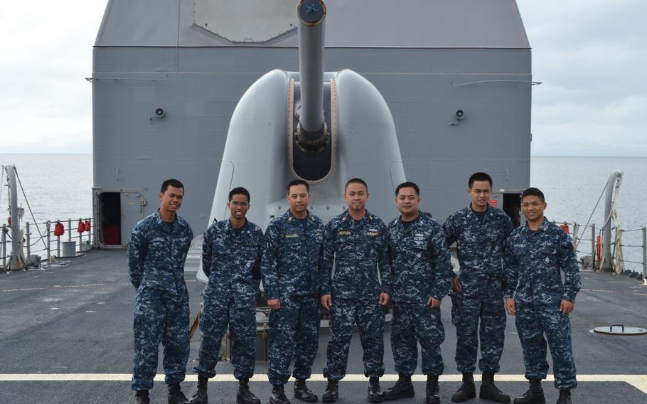 These seven Philippine-born sailors serving aboard the Yokosuka, Japan-based guided missile cruiser USS Cowpens are currently assisting in Typoon Haiyan relief efforts. They are, from left: Seaman Broderick Marteja,  Petty Officer 3rd Class Jireh Pait, Senior Chief Petty Officer Jeruel Simsuango, Chief Petty Officer Conrad Ventura, Petty Officer 1st Class Roel Villasin, Petty Officer 3rd Class Neil Solis. Petty Officer 3rd Class Rainier Samalea.