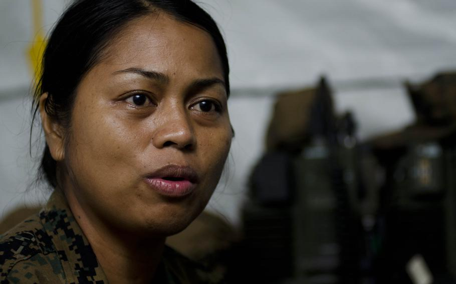 Navy Sr. Chief Vilma Rodriguez, a native of Tacloban, lost two family members in the wake of Super Typhoon Haiyan. She has returned to the city of Tacloban to assist with the relief efforts, and has been searching for her brother's body.