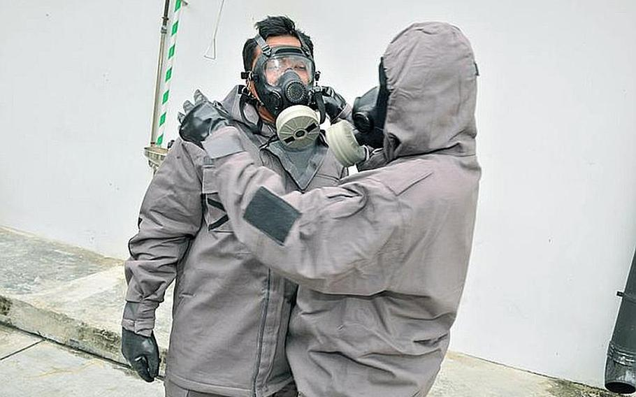 Inspectors from the Organization for the Prohibition of Chemical Weapons are in Hohenfels, Germany, for three days of hostile environment training in preparation for deployments to Syria and other potential hotspots. The Joint Multinational Readiness Center is providing training to about 25 members of the OPCW. In this photo, protective gear is demonstrated during a regional training course on emergency response to chemical incidents held in Singapore in 2011.
