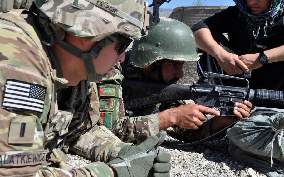 The decision by Afghanistan???s Loya Jirga council to allow foreign advisers to remain in the country after 2014 means that several thousand U.S. and NATO instructors will likely continue to train Afghan forces. In this photo,  an adviser, Lt. Jon Walatkiewicz, works with Afghan National Army troops at Forward Operating Base Joyce in eastern Afghanistan.