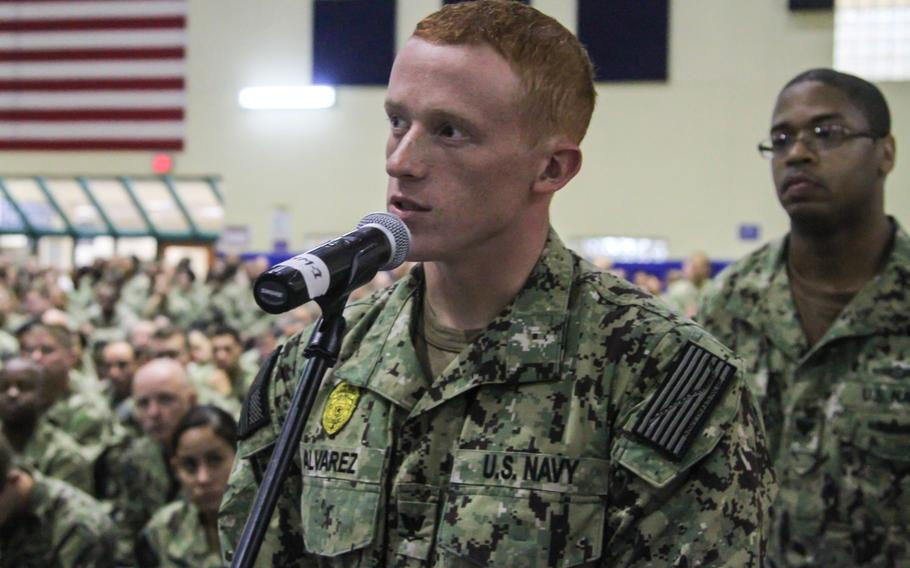 Luke Alvarez, petty officer third class, asks Chief of Naval Operations Adm. Jonathan Greenert about the future strategic direction of the Navy's role in Bahrain, at an all-hands call on Naval Support Activity Bahrain on Wednesday Nov. 27, 2013.