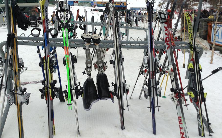 Retired Marine Joshua Elliott's prosthetic legs sit on the rack while he zips up and down the mountain on his monoskis.