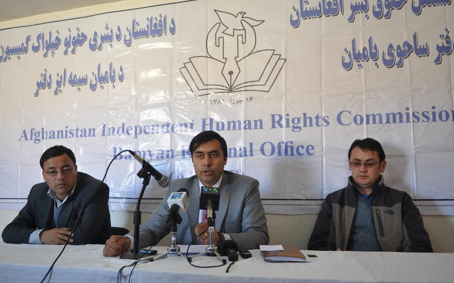 Ruhullah Frogh, center, head of the Human Rights Commission's Bamiyan office, holds a news conference to urge Afghanistan's Independent Election Commission to greatly increase the number of polling stations in high elevation areas to allow voters in snowbound villages access to voting.