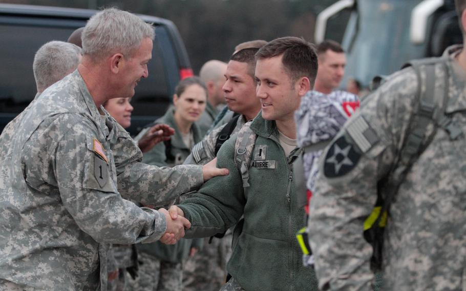 Maj. Gen. Richard Longo, left, deputy commander of U.S. Army Europe, shakes the hands of soldiers from the 5th Battalion, 7th Air Defense Artillery Regiment, Monday, Dec. 2, 2013, before they board a plane for Turkey. About 250 soldiers from the unit are expected to spend a year manning Patriot missile batteries in defense of Turkey, which fears the possibility of missile strikes from Syria, a country consumed by a bloody civil war.