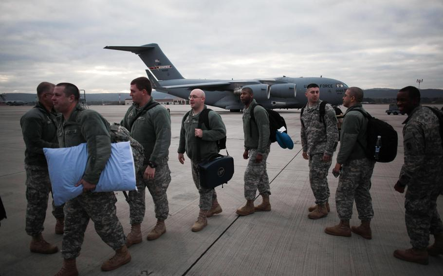 Soldiers of the 5th Battalion, 7th Air Defense Artillery Regiment, wait to board a plane bound for Turkey, where the unit will spend the next year manning Patriot missile batteries to defend Turkey from possible threats from Syria, which is consumed in a bloody civil war.