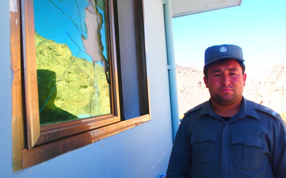 Mirza Hussein, the deputy police chief for Shibar district, a volatile region in Bamyan province, Afghanistan, stands next to a window of his police station smashed by a rocket-propelled grenade. Violence has been rising in parts of the normally quiet province since international troops pulled out in April.