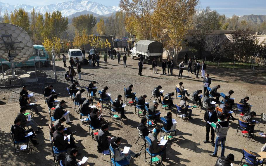 Students take their exams outdoors at Bamiyan University, in the high-mountain city of Bamiyan, Afghanistan. A stronghold of the Hazara minority, who descended from Mongolians, Bamiyan has a distinctly Central Asian feel.