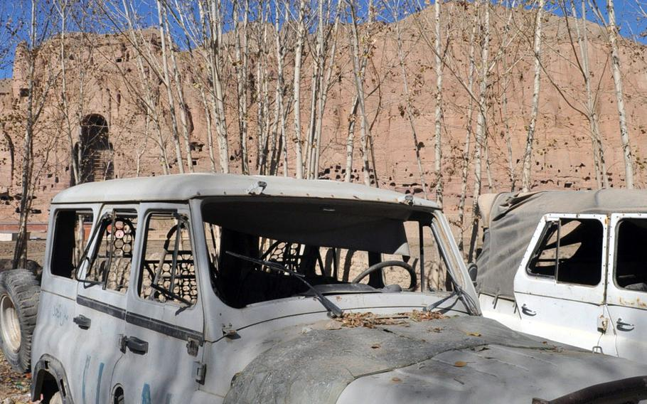 An old United Nations truck sits rusting on the side of a dirt side street in Bamiyan, Afghanistan.