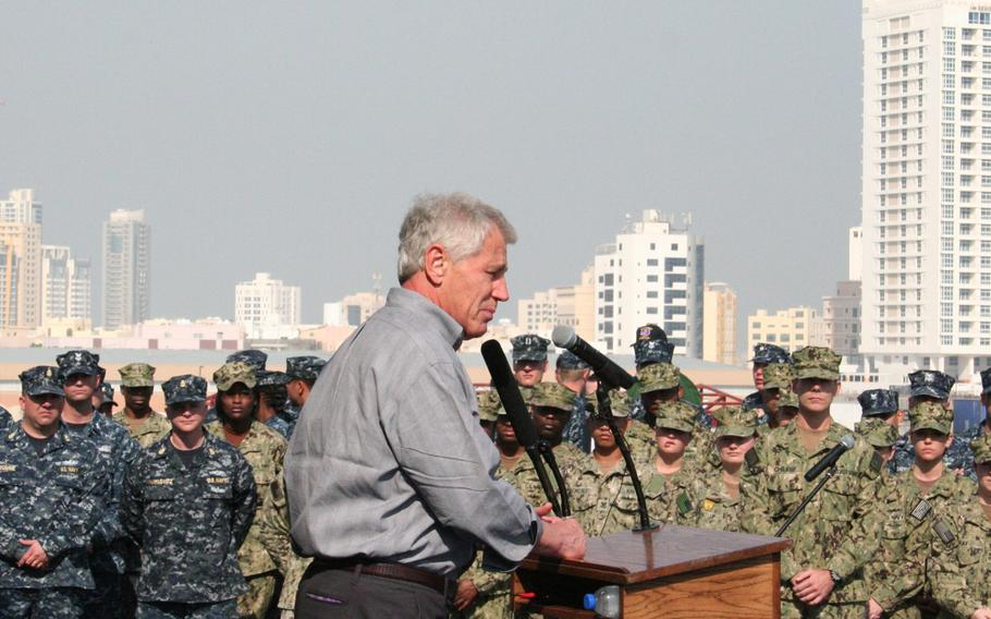 U.S. Defense Secretary Chuck Hagel speaks to servicemembers aboard the USS Ponce, docked at the Mina Salman pier, on Dec. 6, 2013. During his visit to Bahrain. Hagel told the troops that the U.S. posture in the region is unchanged despite a recent nuclear deal with Iran.