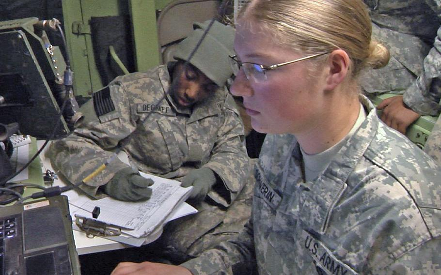 Pvt. Larissa Schwerin, right, and Pvt. Anika Degraff, left, fire direction specialists with Headquarters and Headquarters Battery, 2nd Battalion, 20th Field Artillery Regiment, Task Force Pegasus Fires, process a fire mission request Nov. 19 during a brigade-level training exercise on Fort Hood, Texas.