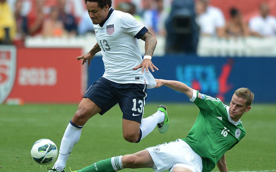 Jermaine Jones (13) has been one of several German-American players with paternal ties to the U.S. military who have contributed to the USMNT's recent success. Here he plays a friendly at RFK Stadium in Washington, D.C., on June 2, 2013.