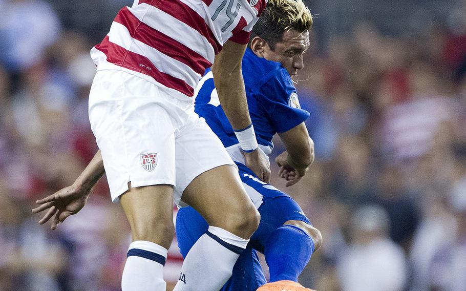 """United States midfielder Danny Williams (14) heads the ball in an Oct. 16, 2012, match at Livestrong Sporting Park in Kansas City, Kansas. Williams told CNN says he told his parents, """"I feel more American than German.'"""""""